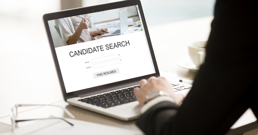 Job recruiting looking at candidate search screen on computer